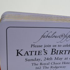 Birthday invitations printed on gold gilt edged cards