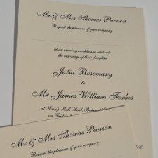 Black thermo printed wedding invites on cream board