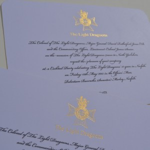 Black thermo & gold foil printed invitations on gold gilt edged cards