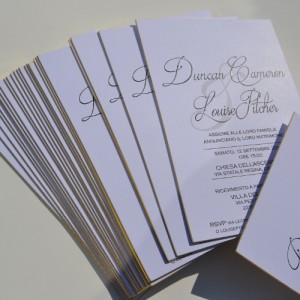 Black thermography printed wedding invitations on gold gilt edged cards